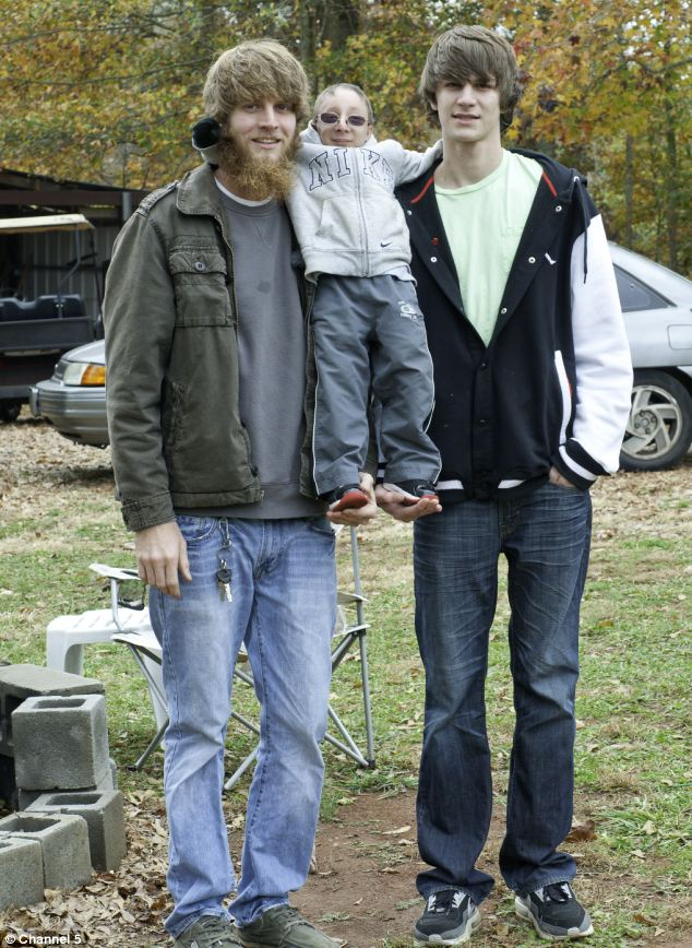 Nick's brothers Travis (pictured right) and Levi (pictured left) have heights that are well above average,unlike Nick Smith who was born with primordial dwarfism
