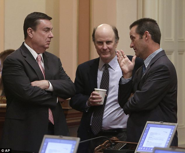 Sticky issue: Republican state Senators, Joel Anderson, left, Mark Wyland, center, and Steve Knight confer as the Senate debated a bill regarding transgender students