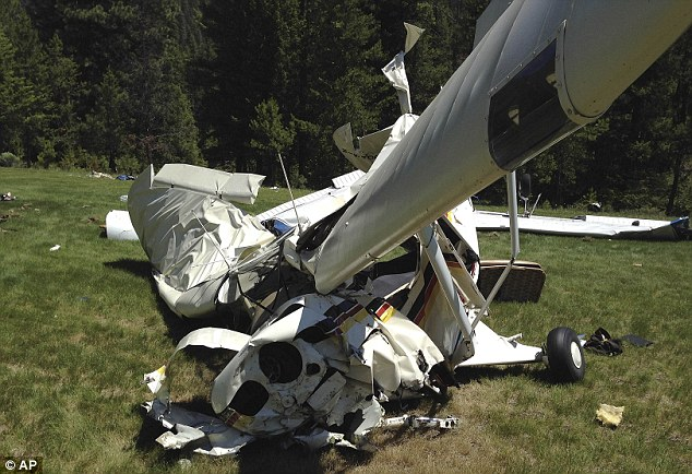 Wreck: The Piper Tri-pacer flown by Chris Jordan was severely damaged by the collision which saw both planes plummet to the ground from 60 feet