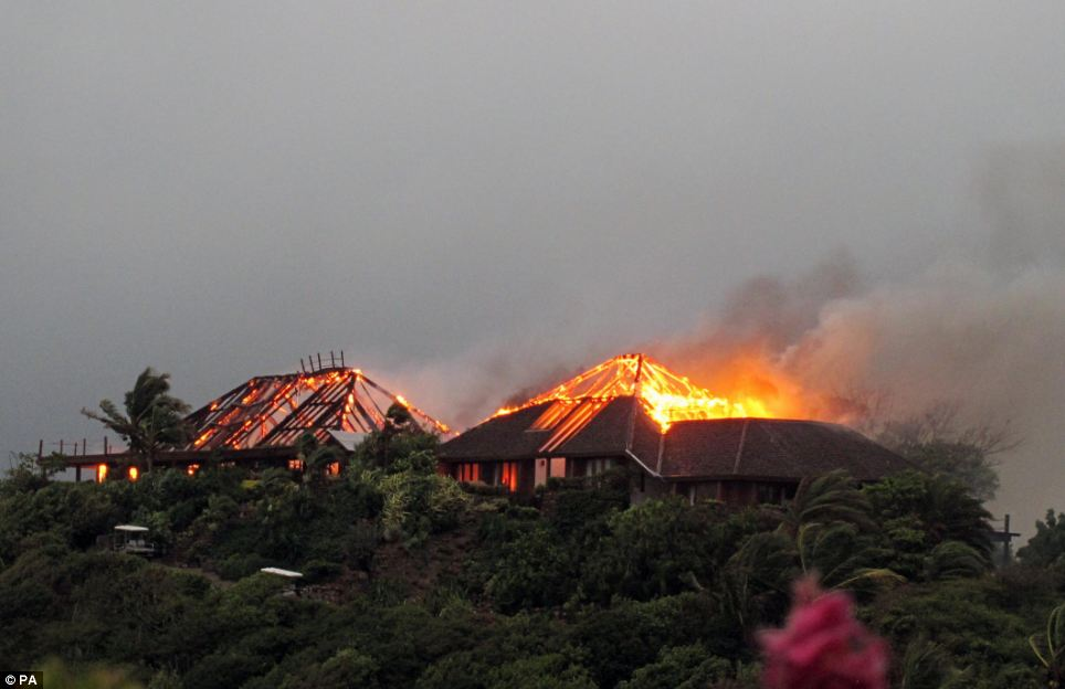 Ablaze: The Great House was gutted by the inferno but all the guests, including Sir Richard Branson's children, managed to escape