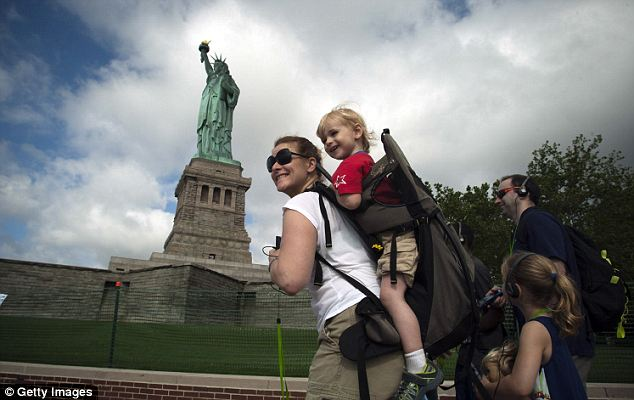 Making their trip: A family tours the newly-reopened Statue of Liberty on the Fourth