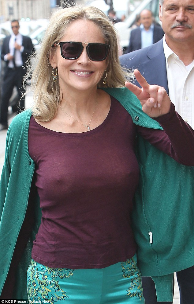 Whoops: The 55-year-old's top was completely see-through when she headed out into the harsh sunlight, revealing that the actress had gone without her undergarments