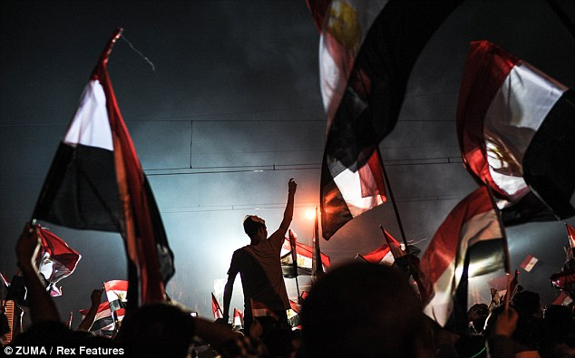 Turmoil: Opponents of President Morsi celebrate his removal near the presidential palace in Cairo