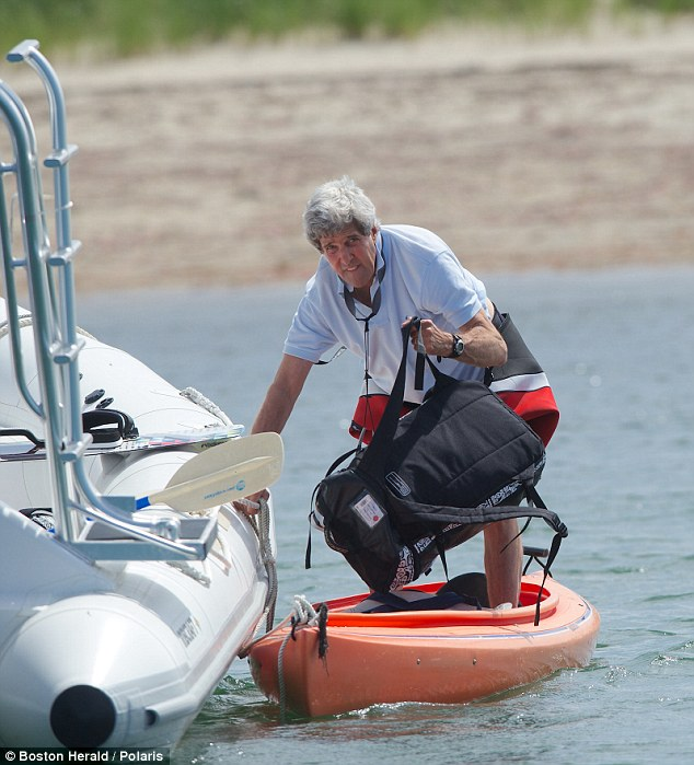 Rough crossing: John Kerry is seen boarding a boat in Nantucket Sound on July 4