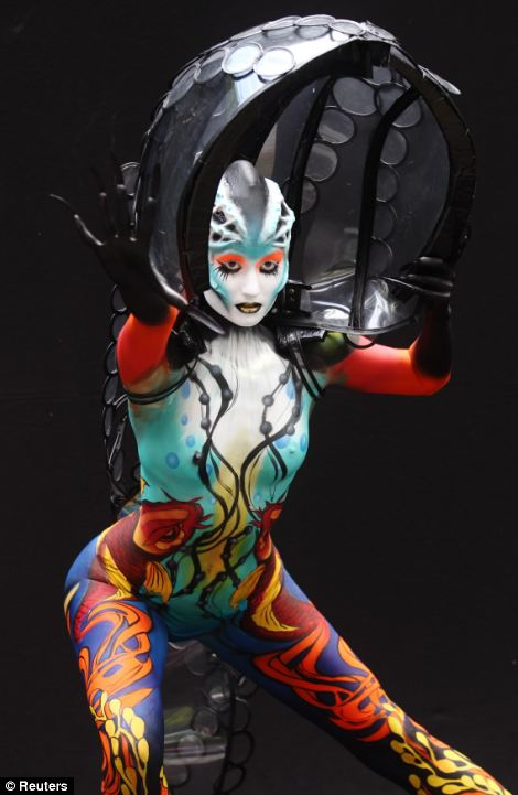 A model poses during the annual World Bodypainting Festival in Poertschach July 5, 2013