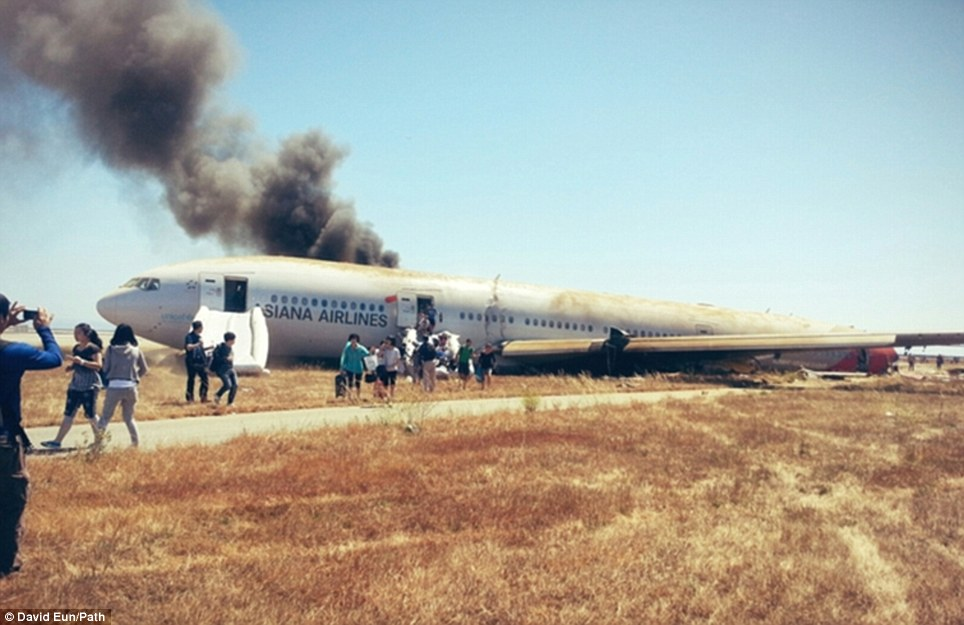 Survivors: Several passengers were able to escape the plane and were photographed by onlookers fleeing the wreck