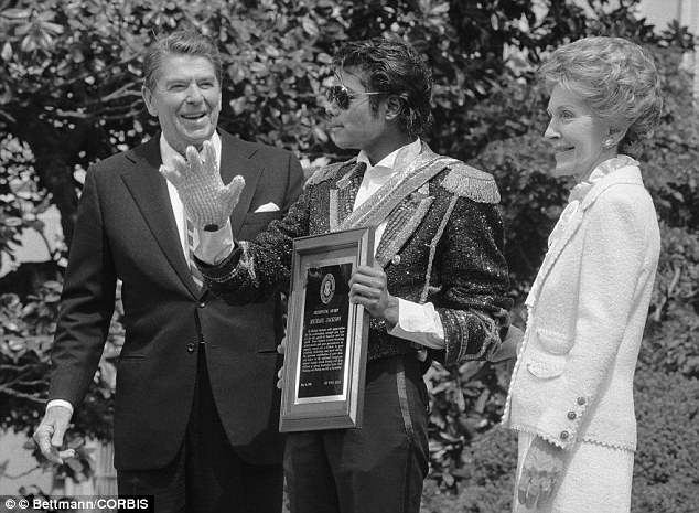 Praised: The President presents Jackson with an award for his help on a drink-driving campaign
