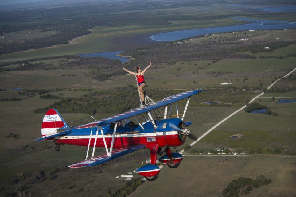 Where no-one has gone before: Ashley has the world record for wing walking, knocking her competition out of the park with an impressive four hours and and two minutes on top of an airplane