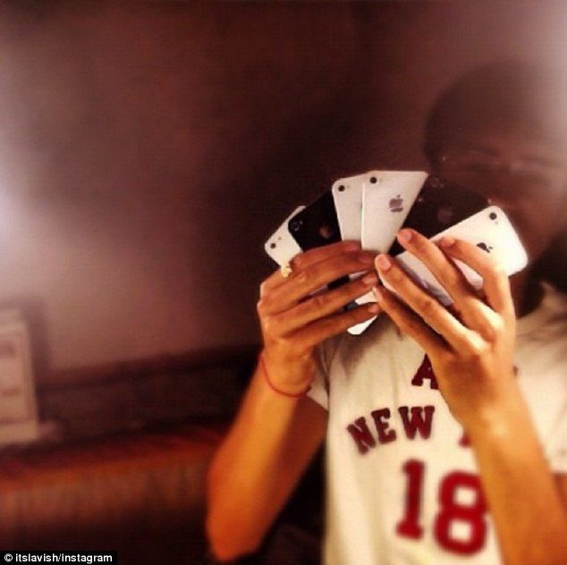 Multi-selfie: Lavish shows off his iPhone 'like playing cards' to his 60,000 Instagram followers