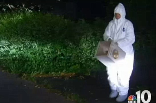 Astounding conditions: Hazmat suits had to be worn by personnel who entered the home as they set about retrieving any living animals that might be present