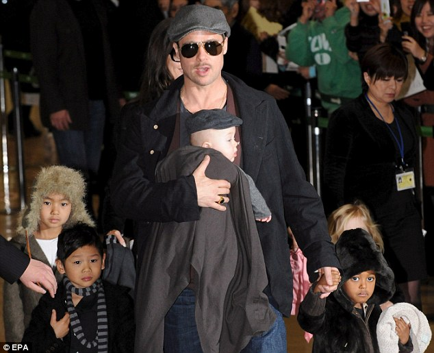 Hollywood royalty: Brad Pitt with five of his six children, from left, Maddox, Pax, Knox, Zahara and, behind Zahara, Shiloh