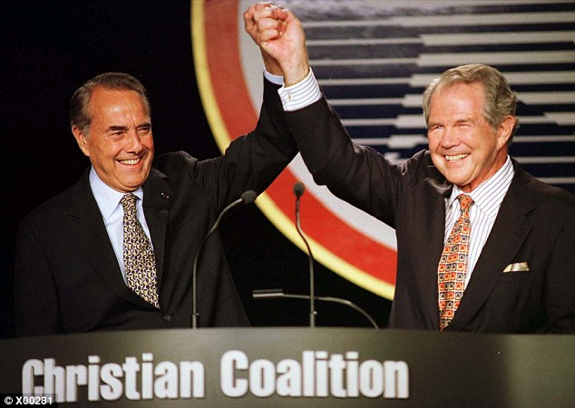 Friends in High Places: Republican presidential nominee Bob Dole (L) greets Christian Coalition supporters with coalition founder Pat Robertson in 1998