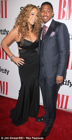 Hazards of the job: Mariah was shooting the video - directed by her husband Nick Cannon - at Avenue nightclub in Chelsea in downtown Manhattan, pictured together in 2012 in LA