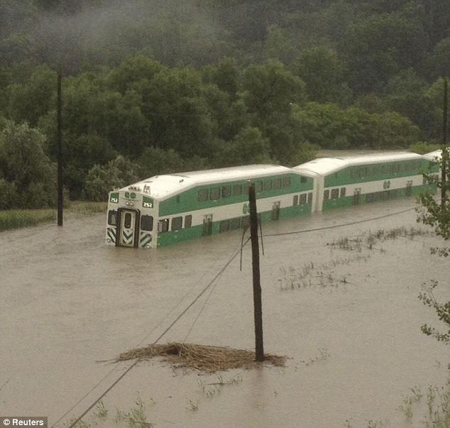 Deep waters: The floods stranded the train on both sides of the track