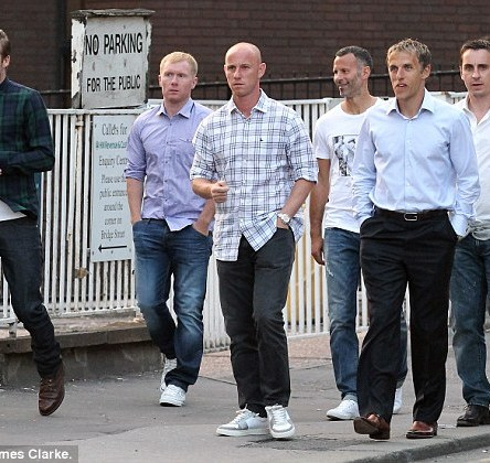 En masse: The footballers looked in high spirits as they grinned and giggled as they caught up in their old stomping ground of Manchester