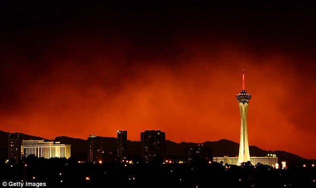 City on fire: Smoke from the Carpenter 1 fire in the Spring Mountains range is illuminated by the setting sun as it billows behind the Stratosphere Casino Hotel in Las Vegas, Nevada