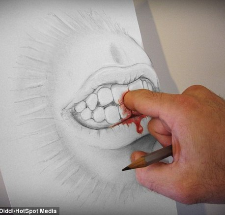 A mouth appears to attack the artist's finger pulling him into the paper for a bite