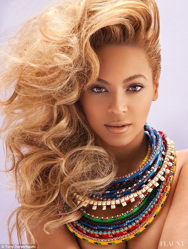 Feeling tribal: The singer wore colourful necklaces and her hair large and voluminous over her shoulder in another picture