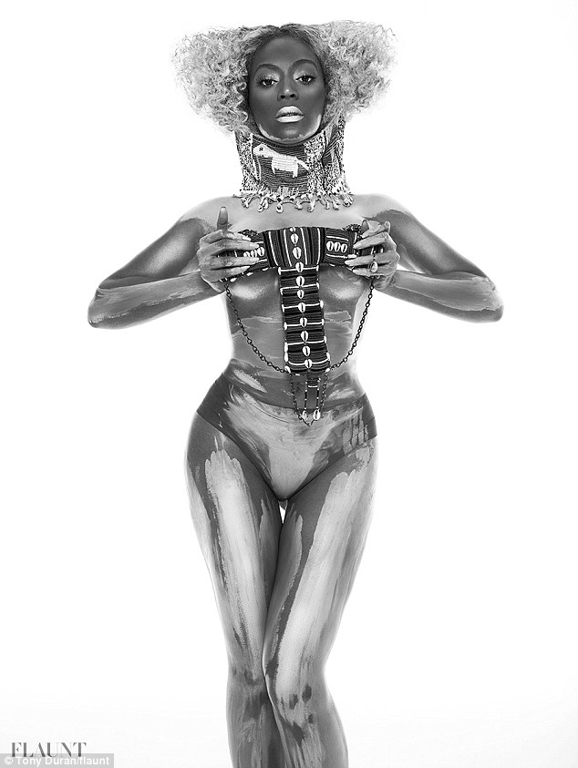 Futuristic femme fatal: Beyonce was smeared in white paint in a striking black-and-white shot, her hair crimped in an unusual style