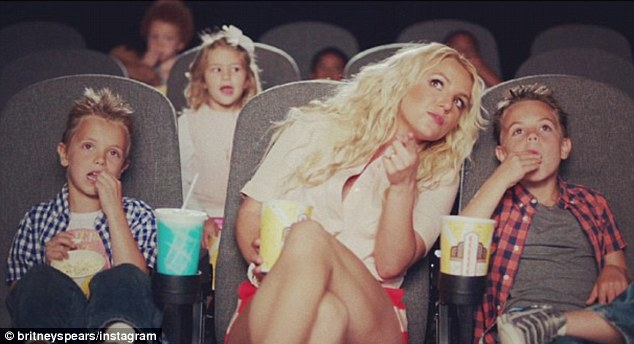 The cutest of cameos: Britney Spears's sons Jayden James, left, and Sean Preston, right, make cameo appearances in their mother's video clip for her new song Ooh La La