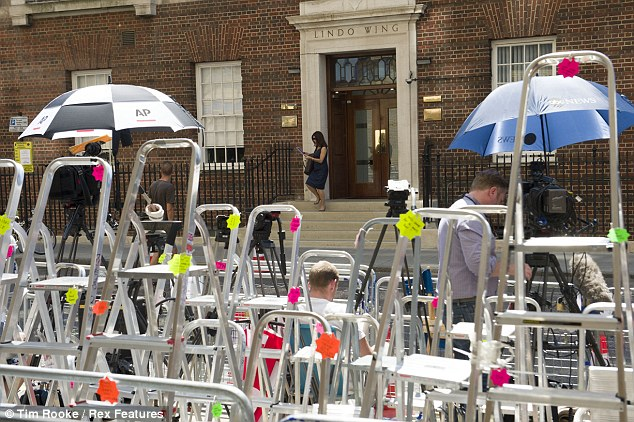 Press pack: Photographers will be jostling for space outside the private wing of the hospital, where Prince William is expected to make a short statement on the steps once the baby's arrival is officially announced