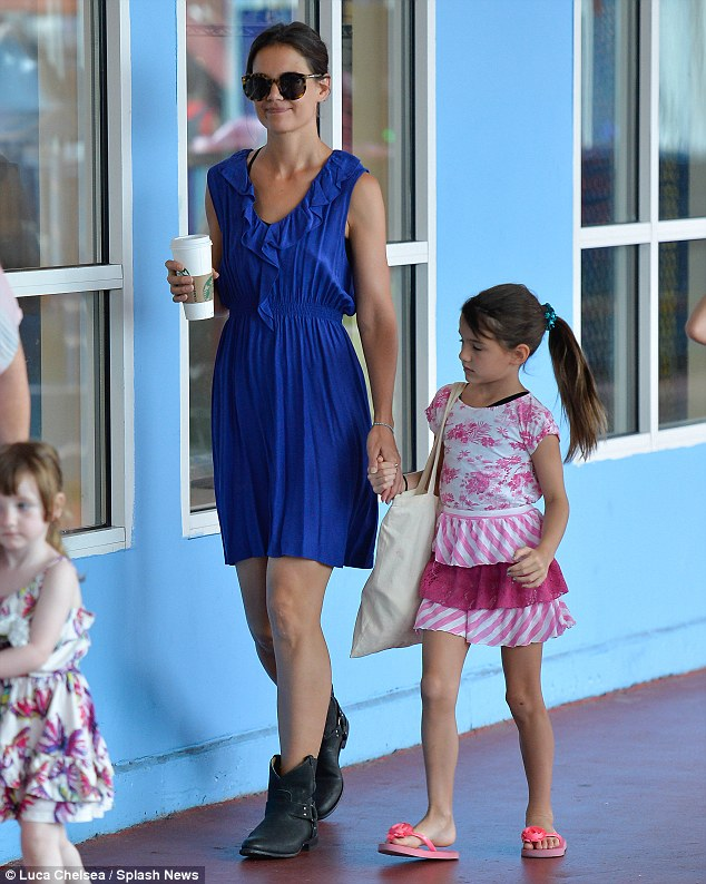 Just the two of us: Katie and Suri walked hand-in-hand during the outing