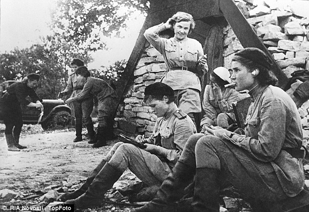 Downtime: Female soviet pilots of the 46th Guards Air Force Regiment relax between missions against Germany during World War II