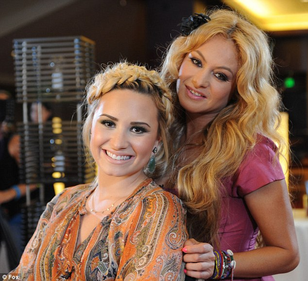 Blonde beauties. Judges Demi and Paulina smile for the cameras