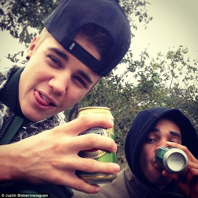 Cause for concern: Bieber posted a snap of himself brandishing a canned beverage with the caption 'Beers in the jungle' in May