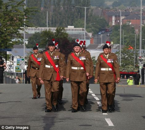 Members of The Royal Regiment march through the streets of Bury, where his funeral will be held. Well-wishers have been asked to show their respects by lining the streets outside
