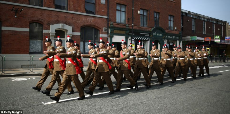 Members of The Royal Regiment of Fusiliers march through the high street for the funeral service of Fusilier Lee Rigby at Bury Parish Church