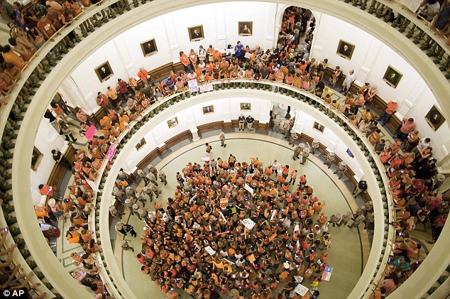 Full house: Abortion rights advocates fill the State Capitol building as the Senate meets for a vote