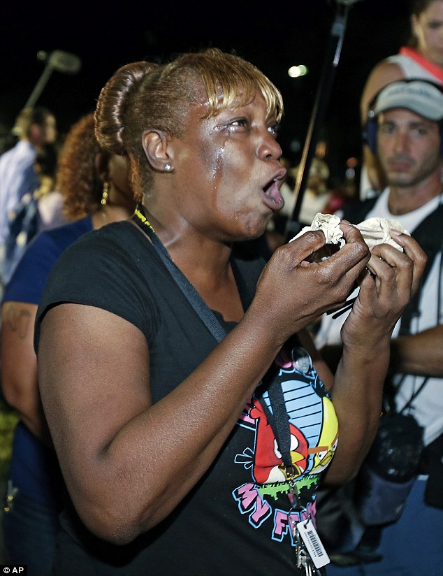 Shock: A Florida woman cries as she hears the not guilty verdict verdict outside the court house