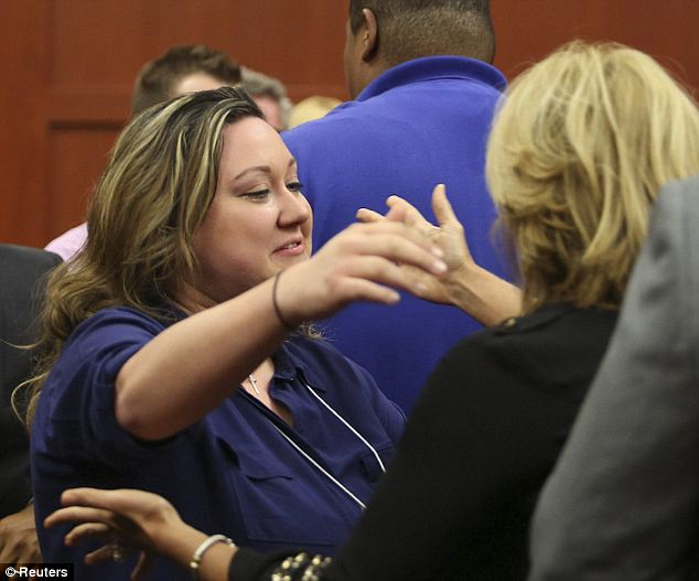 Relief: George Zimmerman's wife, Shellie, celebrates with family and friends following her husband's not guilty verdict