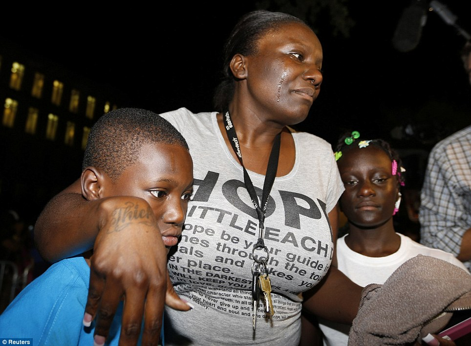 Darssie Jackson holds her children and cries on the lawn of the courthouse after Zimmerman is declared not guilty
