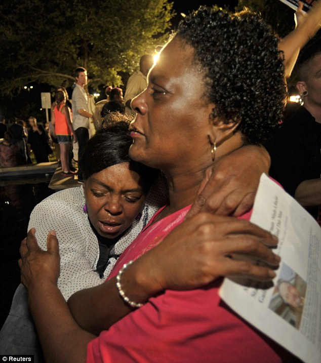 Diane Whitaker (R) comforts Carmen Taylor as they react to the verdict outside Seminole County Court where George Zimmerman was found not guilty on second-degree murder and manslaughter charges in Sanford, Florida