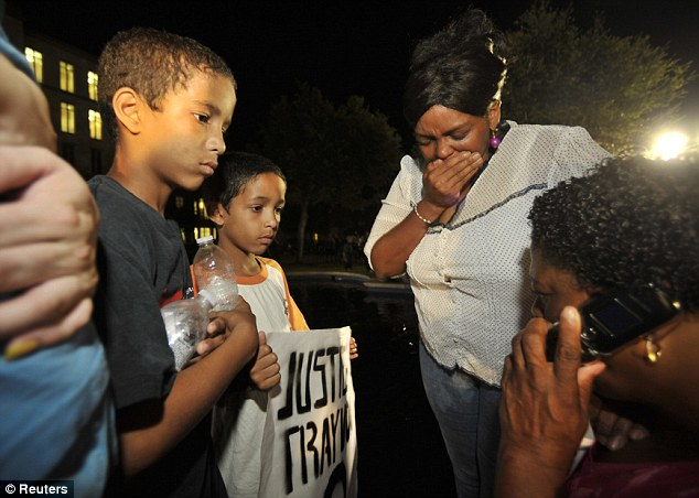 Onlookers react to the verdict outside Seminole County Court where George Zimmerman was found not guilty on second-degree murder and manslaughter charges in Sanford, Florida July 13, 2013