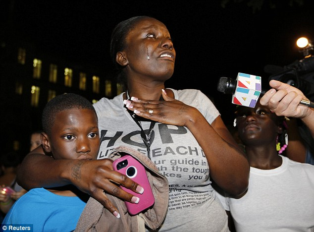 Distress: A mother who was listening to the end of the trial with her children weeps at the jury's decision