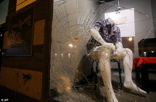 Damage done: A window is smashed at the Sears store on Telegraph Avenue in Oakland, California following the verdict from the five-week trial