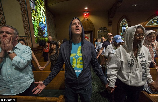 Making a statement: Worshippers at the Middle Collegiate Church hold prayer services wearing hoodies in support of slain teenager Trayvon Martin in response to the acquittal of George Zimmerman in his trial in New York