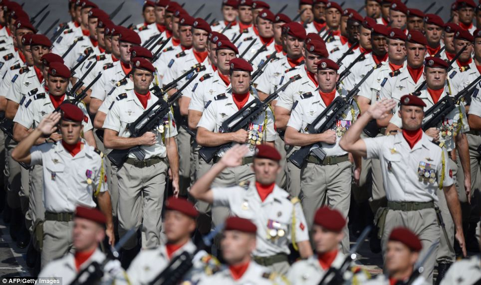 Soldiers of the 35th parachute artillery regiment took part in the annual parade in the strong sunshine