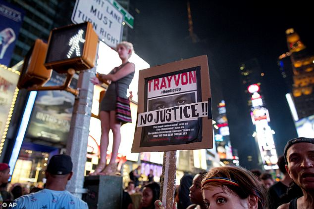'Justice for Trayvon': Protestors of all races and backgrounds swarmed Times Square, angry at the George Zimmerman acquittal. 'Justice for Trayvon' was the night's call to arms