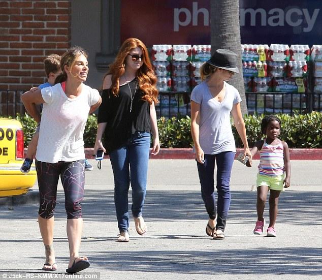 Jillian Michaels Carries Her Growing Young Daughter