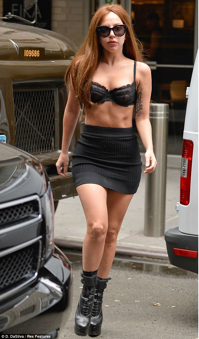 Saucy style: Lady Gaga stepped out in New York City on Thursday in a bra and skirt ensemble