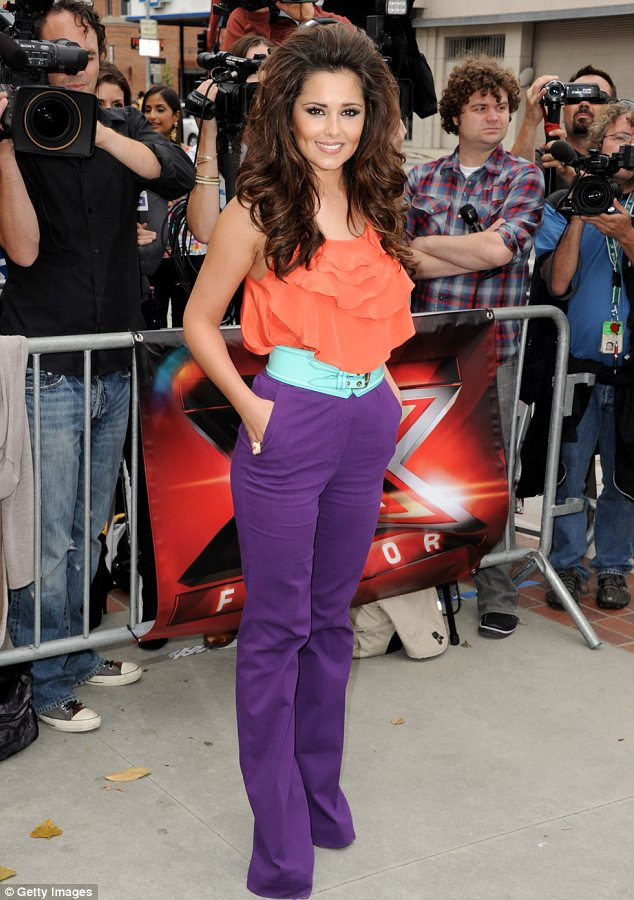 Day one on the job: Cheryl was axed from the show after just three weeks. Seen here making her debut in June 2011
