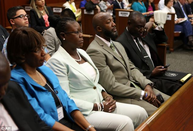 Heartbroken: Trayvon Martin's parents Sabrina Fulton and Tracy Martin sit in court ahead of the verdict; the juror said that her book could spark a discussion on whether laws should be updated