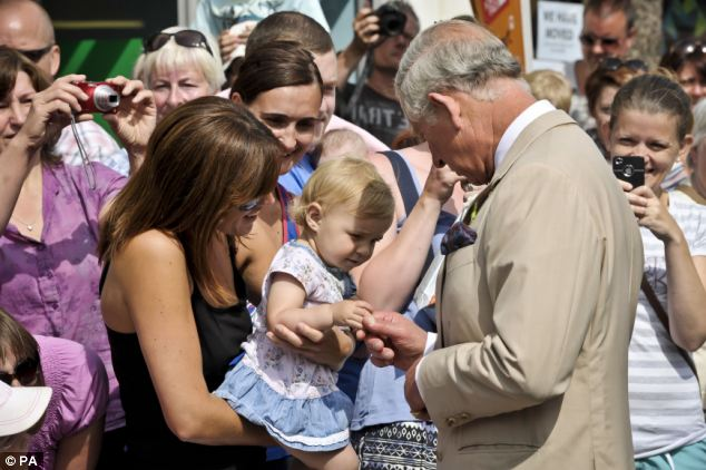 Grandfather-to-be: The Prince seemed thrilled to meet 16-month-old Jasmine Marsh and her mother Jessica