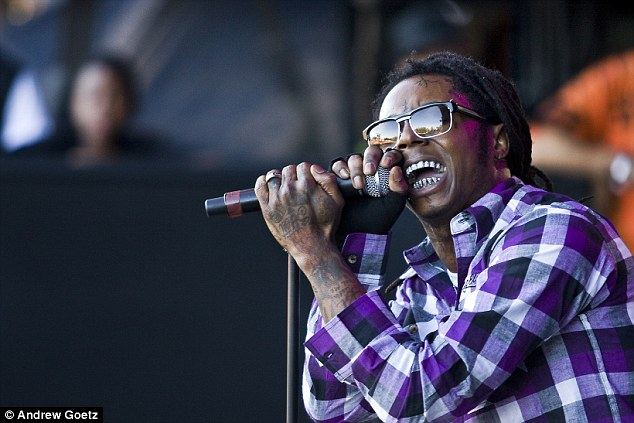 What would he say? Negligent Florida mom Brittany Harris ditched her kids to watch Lil Wayne, pictured, perform at Cruzan Amphitheatre in West Palm Beach