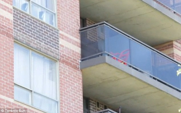 Six stories: This is the balcony a two-year-old boy fell from, landing on concrete below and somehow survived with only minor lacerations to his face