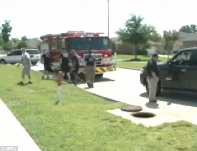 Awful: Firefighters responding to 911 calls about smoke billowing from a sewer found a white pit bull burning to death in the storm drain
